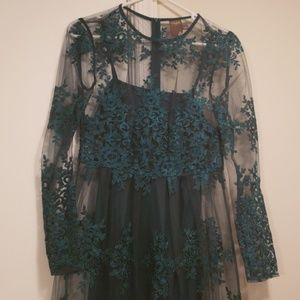 Beautiful emerald dress with lace overlay.